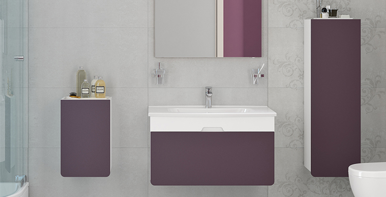Bathroom setting showing VitrA purple D-Light products including washbasin unit and tall cabinet