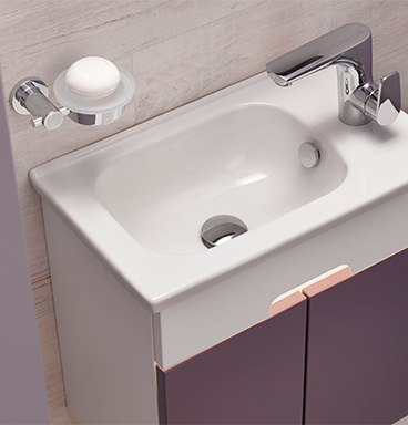 Close up of VitrA D-Light purple compact washbasin unit with wall-mounted soap holder