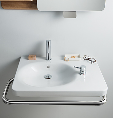 VitrA Nest washbasin with integrated grab bar and glasses sitting on top