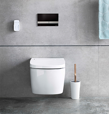 VitrA V-Care shower toilet with black and chrome flush plate
