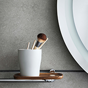Close up of VitrA Eternity shelf and holder with make up brush in