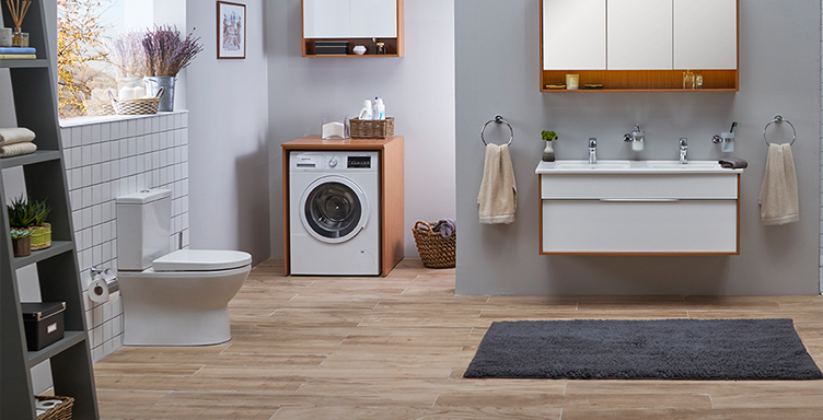 Bathroom setting shower VitrA Integra comfort height toilet, washing machine and vanity unit