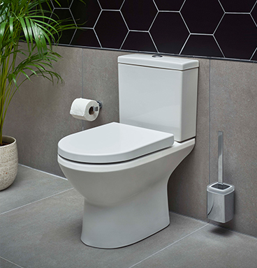 VitrA Integra comfort height toilet against mosaic tiled background