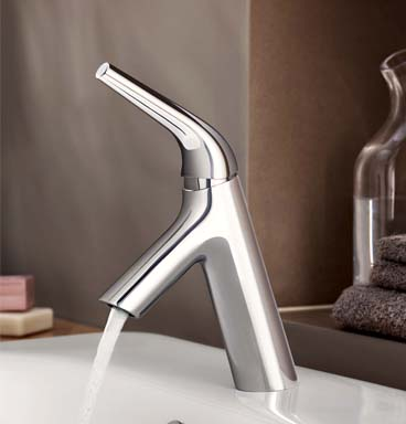VitrA Nest tap with water flowing out