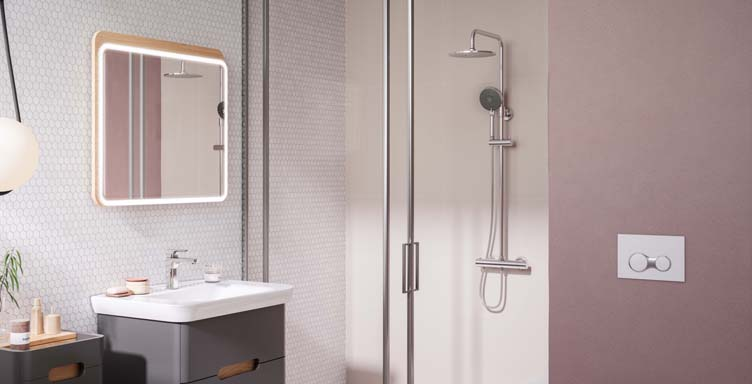 Bathroom setting showing shower valve, hand shower and shower head