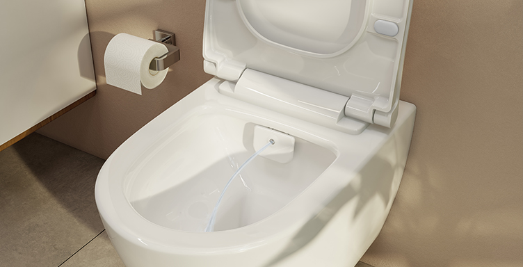 Close up of VitrA Aquacare combined toilet and bidet with water coming out
