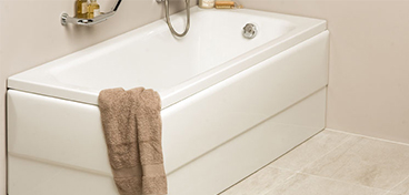VitrA Balance bath with towel draped on the side