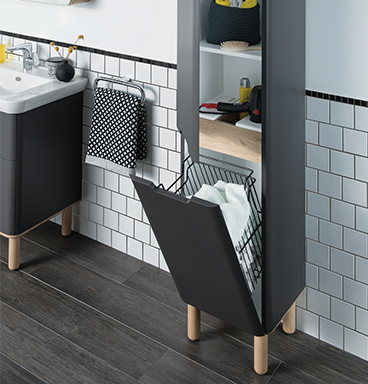 VitrA Sento tall bathroom cabinet with bottom drawer open showing integrated laundry basket